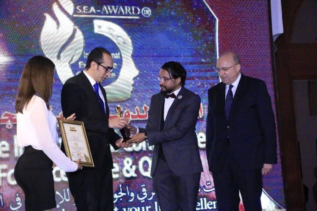 dr mustafa receiving award